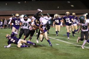 Eric Coley goes airborne after gaining a few yards vs CBA. (Photo by Wendy Cobrda)
